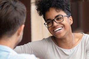 young black woman smiling at white man